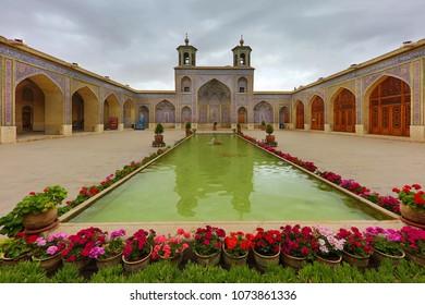 SHIRAZ, IRAN - APRIL 5, 2018: Courtyard of the Pink Mosque known also as Nasir-Ol-Molk Mosque, in Shiraz, Iran.