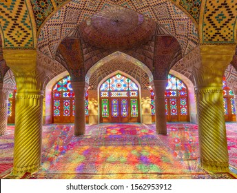 SHIRAZ, IRAN - APRIL 7, 2019: Nasir-ol-molk Mosque known also as Pink Mosque with light through its stained glass windows, in Shiraz, Iran