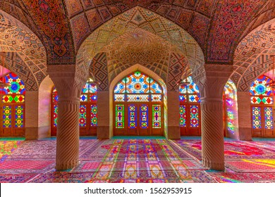 SHIRAZ, IRAN - APRIL 8, 2018: Nasir-ol-molk Mosque known also as Pink Mosque with light through its stained glass windows, in Shiraz, Iran