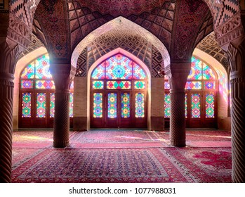 Shiraz, Iran - August 1, 2016 : Interior view of Nasir ol-Molk Mosque, also known as the Pink Mosque, famous for its extensive colorful stained glasses