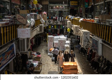 SHIRAZ, IRAN - AUGUST 16, 2018: Shiraz Vakil bazar full of merchandises and goods to be delivered, in a covered alley of the market. Symbol of Persian architecture, it's a major landmark of the city