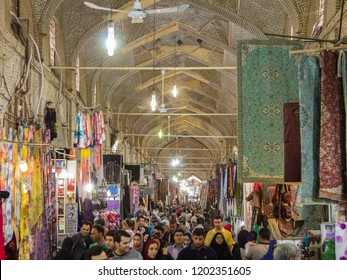SHIRAZ, IRAN - AUGUST 16, 2018: Main hall of the Shiraz Vakil bazar crowded during rush hour, in a covered alley of the market. Symbol of the Persian architecture, it's a major landmark of the city