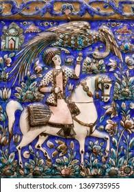 SHIRAZ, IRAN - DECEMBER 22, 2018: Ancient Iranian handmade oriental glazed tile in Abu-Nasr palace