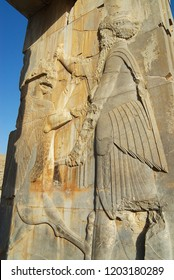 Shiraz, Iran - June 19, 2007: Bas-relief at the ruins of Persepolis in Shiraz, Iran. Persepolis is a UNESCO World Heritage site.
