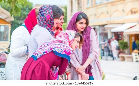 SHIRAZ, IRAN - MAY 04, 2019: Group of Iranian happy girls take a selfie at vakil bazaar Square