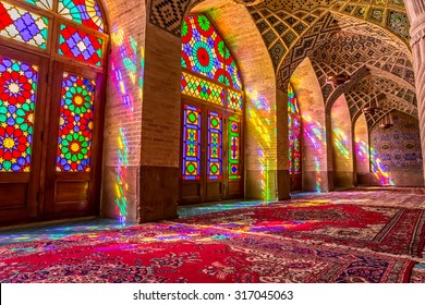 SHIRAZ, IRAN - MAY 2, 2015: Atmosphere in the praying room of the beautiful Nasir Al-Mulk Mosque or Pink Mosque a traditional mosque located in Goad-e-Araban place.