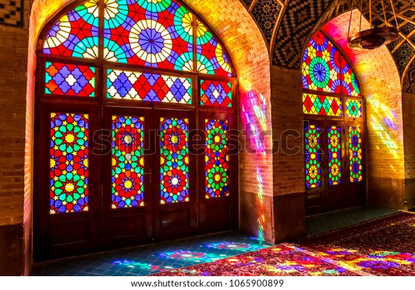 SHIRAZ, IRAN - MAY 2, 2015: Colored windows of the beautiful Nasir Al-Mulk Mosque or Pink Mosque a traditional mosque located in Goad-e-Araban place in Shiraz.