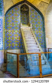 SHIRAZ, IRAN - MAY, 2017: Vakil Mosque Blue and Yellow Tiles Ornament Mihrab Facade