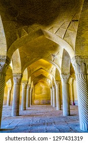 SHIRAZ, IRAN - MAY 2017: Vakil Mosque Prayer Room with Carved Stone Pillars and Bricks Ceiling