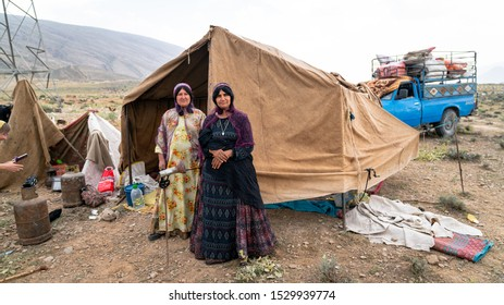 Shiraz, Iran - May 2019: Qashqai nomadic women infront of their tents. The Qasqhai are nomadic people living in temporary villages.