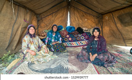 Shiraz, Iran - May 2019: Qashqai nomadic women inside their tents. The Qasqhai are nomadic people living in temporary villages.