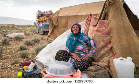 Shiraz, Iran - May 2019: Qashqai nomadic woman infront of her tent. The Qasqhai are nomadic people living in temporary villages.