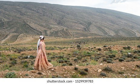 Shiraz, Iran - May 2019: Unidentified Qashqai nomadic woman walking, Iran. The Qasqhai are nomadic people living in temporary villages.