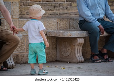SHIRAZ, IRAN - MAY 21, 2014: a european kid is visiting one of an ancient region of shiraz, with him father.