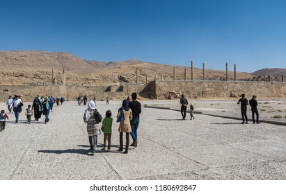 Shiraz, Iran, November 10th, 2017: Tourists visiting the Persepolis in Shiraz, Iran. The ceremonial capital of the Achaemenid Empire. UNESCO World Heritage