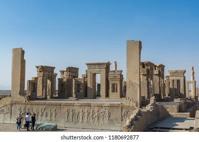 Shiraz, Iran, November 10th, 2017: Tourists at the ruins of the Tachara in the Persepolis in Shiraz, Iran. The ceremonial capital of the Achaemenid Empire. UNESCO World Heritage