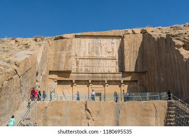 Shiraz, Iran, November 10th, 2017: Tourists visiting the Tomb of Artaxerxes II in the Persepolis in Shiraz, Iran. The ceremonial capital of the Achaemenid Empire. UNESCO World Heritage