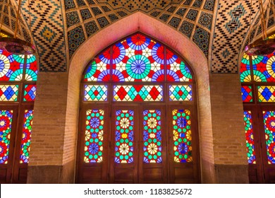 Shiraz, Iran, November 10th, 2017: Colorful shining stained glass windows of Nasir Al-Mulk Mosque (Pink Mosque) in Shiraz, Iran.