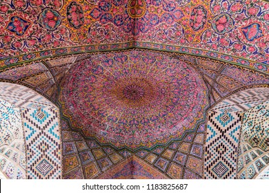 Shiraz, Iran, November 10th, 2017: Colorful and rosy mosaic  patterns on the ceiling of Nasir Al-Mulk Mosque (Pink Mosque) in Shiraz, Iran