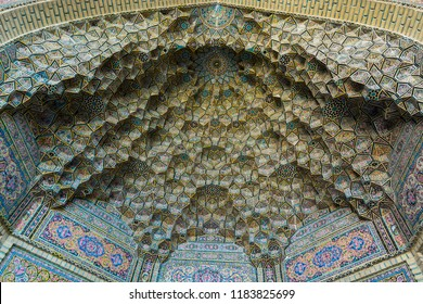 Shiraz, Iran, November 10th, 2017: Colorful mosaic  patterns and architectural details on the ceiling of Nasir Al-Mulk Mosque (Pink Mosque) in Shiraz, Iran