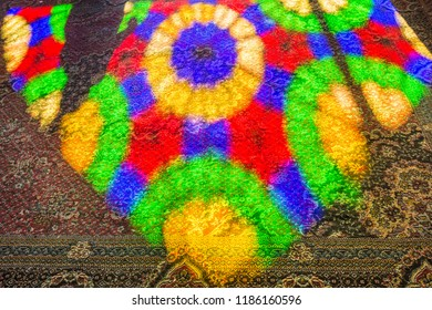 Shiraz, Iran, November 10th, 2017: Colorful light on the carpet from the stained tiles windows of Nasir Al-Mulk Mosque (Pink Mosque) in the morning in Shiraz, Iran.