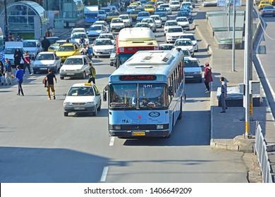 SHIRAZ, IRAN - NOVEMBER 17, 2018 - Typical traffic with a Shiraz public bus on Karim Khan Zand blvd