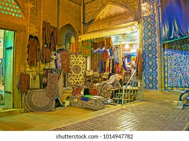 SHIRAZ, IRAN - OCTOBER 12, 2017: The store with tapestries, carpets and traditional clothes is located between the portal of Vakil Mosque and central entrance to Vakil Bazaar, on October 12 in Shiraz.