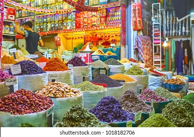 SHIRAZ, IRAN - OCTOBER 12, 2017: The mounds and heaps of spices, herbs, nuts and dried fruits in stall of Vakil Market, on October 12 in Shiraz.