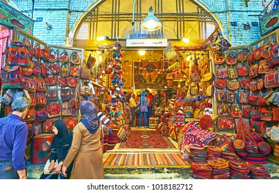 SHIRAZ, IRAN - OCTOBER 12, 2017: The large showcase of the carpet store in Vakil Bazaar with wide range of bags, decorated with woven details, on October 12 in Shiraz.