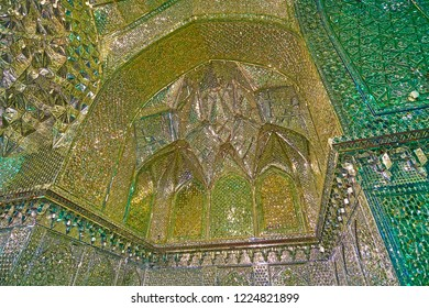 SHIRAZ, IRAN - OCTOBER 12, 2017: The carved niche with muqarnas details in Mirror Hall of Imamzadeh Ali Ibn Hamzeh Holy Shrine, on October 12 in Shiraz