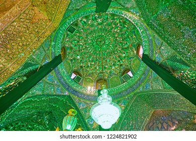 SHIRAZ, IRAN - OCTOBER 12, 2017: The cupola in Mirror Hall of Imamzadeh Ali Ibn Hamzeh Holy Shrine with complex muqarnas decoration, covered with pieces of mirror, on October 12 in Shiraz.