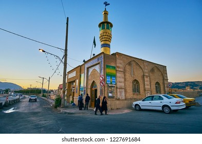 SHIRAZ, IRAN - OCTOBER 12, 2017: The visitors at the small mosque with shiny gold minaret, located at the busy Pishro street, on October 12 in Shiraz