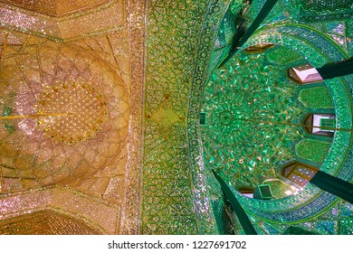 SHIRAZ, IRAN - OCTOBER 12, 2017: Mirror Hall of Imamzadeh Ali Ibn Hamzeh Shrine - two domes, divided with ornate arch and decorated with muqarnas and patterns of glass pieces, on October 12 in Shiraz