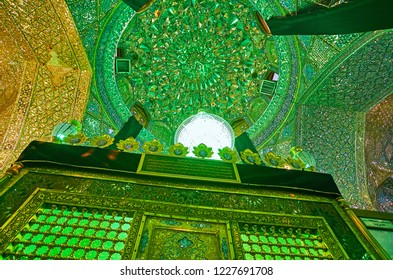 SHIRAZ, IRAN - OCTOBER 12, 2017: Mausoleum of Imamzadeh Ali Ibn Hamzeh Shrine is located in ornate Mirror Hall, that boasts masterpiece mirrorwork and complex carved decors, on October 12 in Shiraz