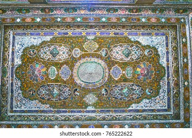 SHIRAZ, IRAN - OCTOBER 12, 2017: Mirror ceiling in terrace of Qavam (Ghavam) House of Naranjestan, patterns of colored mirrors are neighboring with elements, painted on wood, on October 12 in Shiraz.