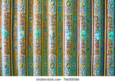 SHIRAZ, IRAN - OCTOBER 12, 2017: The medieval timber ceiling in chamber of Qavam (Ghavam) House of Naranjestan is covered with complex painted patterns, on October 12 in Shiraz.