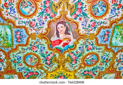 SHIRAZ, IRAN - OCTOBER 12, 2017: The beautiful female portrait on the wooden ceiling of the side room in Qavam House, Naranjestan complex, on October 12 in Shiraz.