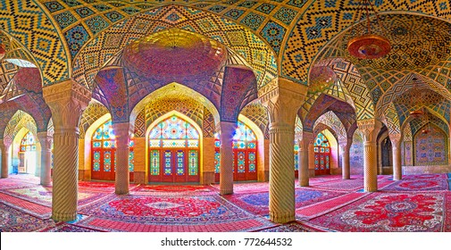 SHIRAZ, IRAN - OCTOBER 12, 2017: Panorama of the winter prayer hall of the Pink mosque (Nasir Ol-Molk) with numerous carved columns, stained glass windows and tiled vault, on October 12 in Shiraz.