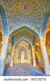 SHIRAZ, IRAN - OCTOBER 12, 2017: The shabestan (prayer hall) of Vakil Mosque with a view on mihrab and domes, richly decorated with tiled islamic patterns, on October 12 in Shiraz.