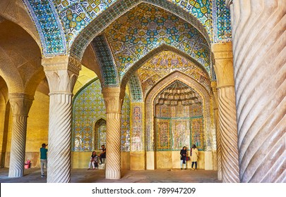 SHIRAZ, IRAN - OCTOBER 12, 2017: The central part of the wall and vault of Vakil Mosque is decorated with glazed tiles, covered with traditional islamic patterns, on October 12 in Shiraz.