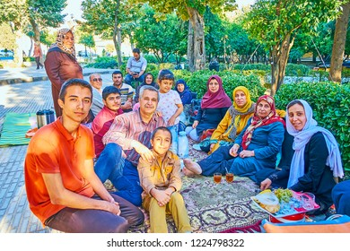 SHIRAZ, IRAN - OCTOBER 13, 2017:  Large Iranian family with kids on traditional Friday picnic in Hafezieh public park, on October 13 in Shiraz.