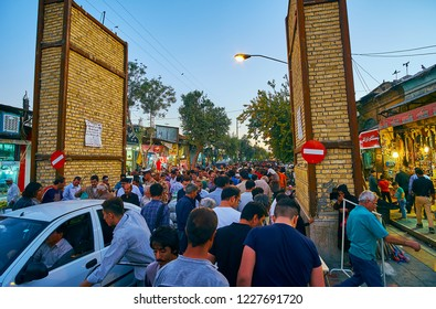 SHIRAZ, IRAN - OCTOBER 14, 2017: The crowded street of Bazar-e No, evening is busy time here, numerous male visitors walk this way after the pray in local mosques, on October 14 in Shiraz.