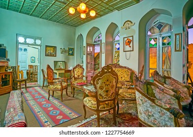 SHIRAZ, IRAN - OCTOBER 14, 2017: Family restaurant in historic mansion: the room is decorated in classic style with vintage carved furniture, carpets and stained-glass windows, on October 14 in Shiraz