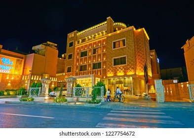 SHIRAZ, IRAN - OCTOBER 14, 2017: The  modern hotel complex, located in old town and decorated with relief brick pattern in same style with historic Karim Khan Citadel, on October 14 in Shiraz