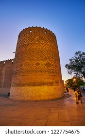 SHIRAZ, IRAN - OCTOBER 14, 2017: The medieval brick tower of Karim Khan citadel is covered with relief brick pattern, on October 14 in Shiraz.