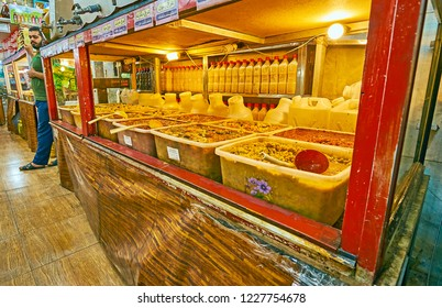 SHIRAZ, IRAN - OCTOBER 14, 2017: The store of Iranian pickles (torshi) with wide range of pickled, salted, spicy, garlicky vegetables, prepared by old recipes with local herbs, on October 14 in Shiraz