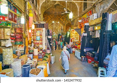 SHIRAZ, IRAN - OCTOBER 14, 2017: Alley of Vakil Bazaar is always crowded, local stalls offer fragrant spices, dried fruits, herbs, cereals and nuts, it's popular tourist place, on October 14 in Shiraz