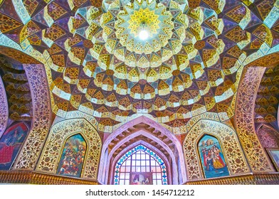 SHIRAZ, IRAN - OCTOBER 14, 2017: The cupola in hall of Kolah Farangi pavilion (Pars museum)  with muqarnas carvings and rich floral pattern, on October 14 in Shiraz