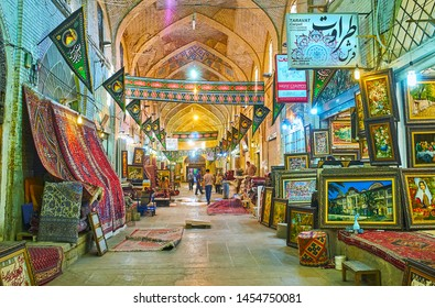 SHIRAZ, IRAN - OCTOBER 14, 2017: Walk the alleyway of carpet section in Vakil Bazaar and watch Persian carpets, authentic rugs, tapestries and kilims, on October 14 in Shiraz.