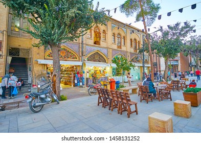 SHIRAZ, IRAN - OCTOBER 14, 2017: The small outdoor cafes line Zand walk street, attracting tourists to try local snacks and cool drinks, on October 14 in Shiraz.